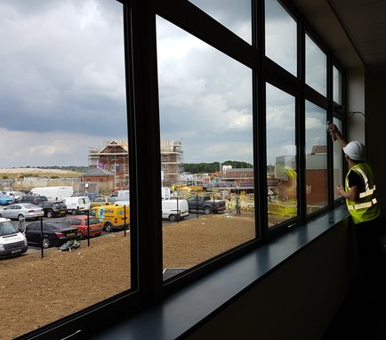 BL Property Services operative window cleaning on building site